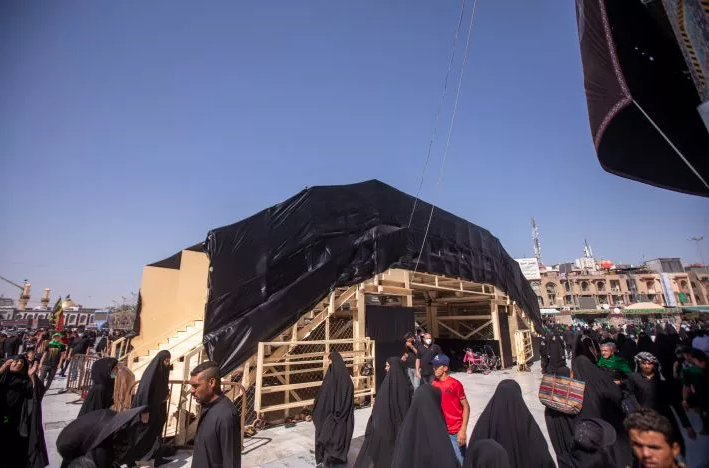 Within the service preparations for the Ziyarat Arba'een, the department of Engineering Maintenance Department is installing the temporary iron bridge to facilitate the movements of visitors.