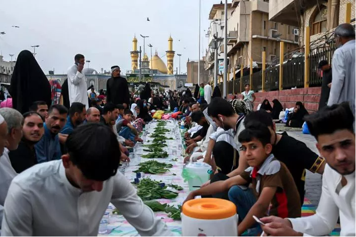 Hussayni service processions offer Iftar tables in Karbala