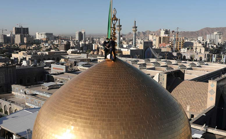 Changing dome flag ritual was held at holy shrine of Imam Reza (AS)